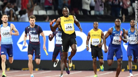 Jamaica's Usain Bolt pulls up sharply on the final leg of the men's sprint relay on his track farewell.