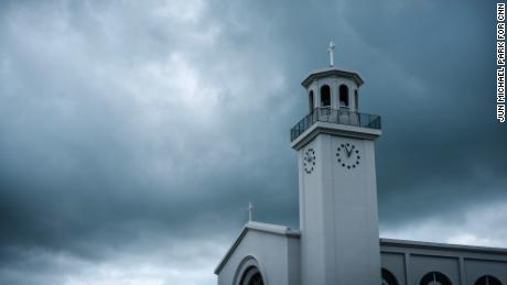 Heavy clouds hover over Dulce Nombre de Maria Cathedral-Basilica in Hagatna, Guam on August 13.