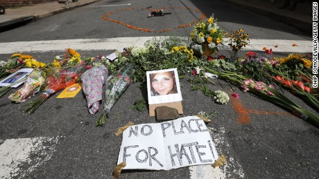 CHARLOTTESVILLE, VA - AUGUST 13:  Flowers surround a photo of 32-year-old Heather Heyer, who was killed when a car plowed into a crowd of people protesting against the white supremacist Unite the Right rally, August 13, 2017 in Charlottesville, Virginia. Charlottesville is calm the day after violence errupted around the Unite the Right rally, a gathering of white nationalists, neo-Nazis, the Ku Klux Klan and members of the 'alt-right,' that left Heyer dead and injured 19 others.  (Photo by Chip Somodevilla/Getty Images)