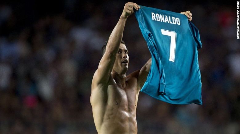 Ronaldo, as Messi did a few weeks ago, raises his shirt to the crowd after scoring.