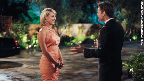 "BACHELOR PAD - ""Episode 201"" -- Hosted by Chris Harrison (""The Bachelor,"" ""The Bachelorette""), ""Bachelor Pad"" returns MONDAY, AUGUST 8 (8:00-11:00 p.m., ET) with its most controversial cast to date, as 18 unforgettable characters from the ""Bachelor"" franchise - those we love and those we love to hate -- gather back at the mansion to live together and compete for $250,000 and possibly a second chance at love. The drama begins as the contestants move into the ""Bachelor"" mansion to meet their fellow competitors on a night where Jake Pavelka and Vienna Girardi will come face to face for the first time since their unforgettable primetime showdown. In their first challenge, the ""Hook Up,"" the men and women will pair off into couples clinging to each other 10-feet high. The couple who can hang on to each other the longest will win the challenge and be saved from elimination. At the end of the episode, one man and one woman will be voted off. (Photo by Greg Zabilski/ABC via Getty Images)VIENNA GIRARDI, CHRIS HARRISON"