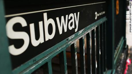 NEW YORK, NY - DECEMBER 05: A man walks past a subway stop in Manhattan two days after a man was pushed to his death in front of a train on December 5, 2012 in New York City. The incident was caught by a photographer and has since raised questions as to why someone didn't help the man before the train struck him. The New York City subway system, with 468 stations in operation, is the most extensive public transportation system in the world. It is also one of the world's oldest public transit systems, with the first underground line of the subway opening on October 27, 1904.  (Photo by Spencer Platt/Getty Images)