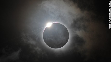 The Diamond Ring effect is shown following totality of the solar eclipse at Palm Cove in Australia's Tropical North Queensland on November 14, 2012.