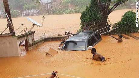 TOPSHOT - This handout picture released on August 14, 2017, by Society 4 Climate Chnage Communication Sierra Leone, shows flooded streets in Regent near Freetown.