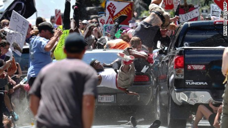 People fly into the air as a vehicle drives into a group of protesters demonstrating against a white nationalist rally in Charlottesville, Va., Saturday, Aug. 12, 2017. The nationalists were holding the rally to protest plans by the city of Charlottesville to remove a statue of Confederate Gen. Robert E. Lee. (Ryan M. Kelly/The Daily Progress via AP)