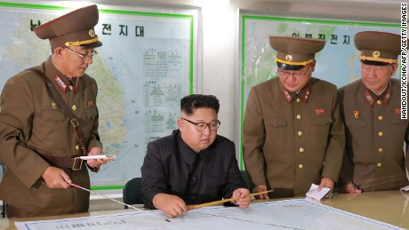 "TOPSHOT - This picture taken on August 14, 2017 and released from North Korea's official Korean Central News Agency (KCNA) on August 15, 2017 shows North Korean leader Kim Jong-Un (C) inspecting the Command of the Strategic Force of the Korean People's Army (KPA) at an undisclosed location. North Korean leader Kim Jong-Un said on August 15 he would hold off on a planned missile strike near Guam, but warned the highly provocative move would go ahead in the event of further ""reckless actions"" by Washington. / AFP PHOTO / KCNA VIA KNS / STR / South Korea OUT / REPUBLIC OF KOREA OUT   ---EDITORS NOTE--- RESTRICTED TO EDITORIAL USE - MANDATORY CREDIT ""AFP PHOTO/KCNA VIA KNS"" - NO MARKETING NO ADVERTISING CAMPAIGNS - DISTRIBUTED AS A SERVICE TO CLIENTS THIS PICTURE WAS MADE AVAILABLE BY A THIRD PARTY. AFP CAN NOT INDEPENDENTLY VERIFY THE AUTHENTICITY, LOCATION, DATE AND CONTENT OF THIS IMAGE. THIS PHOTO IS DISTRIBUTED EXACTLY AS RECEIVED BY AFP.  /         (Photo credit should read STR/AFP/Getty Images)"