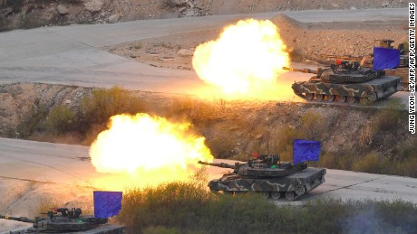 South Korean K1A2 tanks fire live rounds during a joint live firing drill between South Korea and the US at the Seungjin Fire Training Field in Pocheon, 65 kms northeast of Seoul, on April 26, 2017. / AFP PHOTO / JUNG Yeon-Je        (Photo credit should read JUNG YEON-JE/AFP/Getty Images)