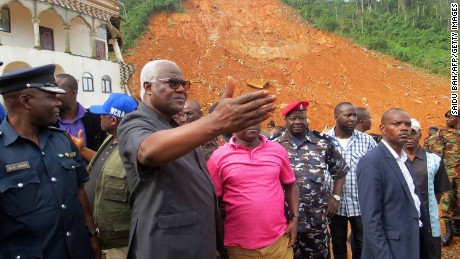 Sierra Leone's President Ernest Bai Koroma visits the site of a mudslide near Freetown on Tuesday.