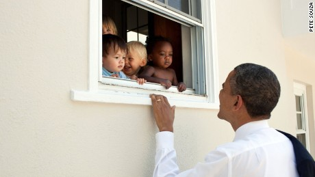 President Barack Obama greets children at a day care facility adjacent to daughter Sasha's school in Bethesda, Md., following her 4th grade closing ceremony, June 9, 2011.
