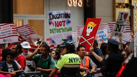 Protesters gather near Trump Tower to protest against attacks on immigrants under policies of US President Donald Trump, August 15, 2017 in New York. / AFP PHOTO / Eduardo MUNOZ ALVAREZ        (Photo credit should read EDUARDO MUNOZ ALVAREZ/AFP/Getty Images)
