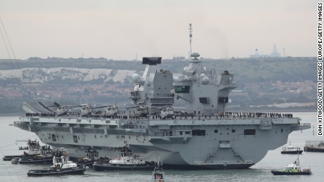 PORTSMOUTH, ENGLAND - AUGUST 16:  The HMS Queen Elizabeth arrives on August 16, 2017 in Portsmouth, England.  The HMS Queen Elizabeth is the lead ship in the new Queen Elizabeth class of supercarriers. Weighing in at 65,000 tonnes she is the largest war ship deployed by the British Royal Navy.  She is planned to be in service by 2020 and with a second ship, HMS Prince of Wales, to follow.  (Photo by Dan Kitwood/Getty Images)