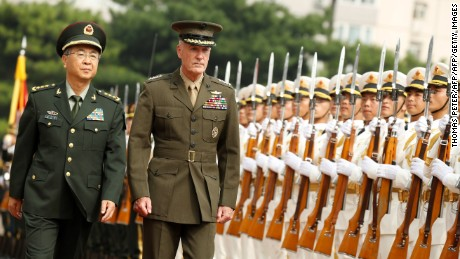 Chairman of the US Joint Chiefs of Staff, General Joseph Dunford (2nd L), and his Chinese counterpart, chief of the general staff of the Chinese People's Liberation Army, General Fang Fenghui (L), attend a welcoming ceremony in Beijing on August 15, 2017. Dunford is visiting Beijing as part of a trip which will includes South Korea and Japan.  / AFP PHOTO / POOL / THOMAS PETER        (Photo credit should read THOMAS PETER/AFP/Getty Images)