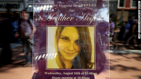 A poster announcing the memorial service for Heather Heyer, who was killed when a car slammed into a crowd of people protesting against a white supremacist rally, stands in the window of the Paramount Theater August 16, 2017 in Charlottesville, Virginia. Charlottesville will hold a memorial service for Heyer Wednesday, four days after she was killed when a participant in a white nationalist, neo-Nazi rally allegedly drove his car into the crowd of people demonstrating against the 'alt-right' gathering.