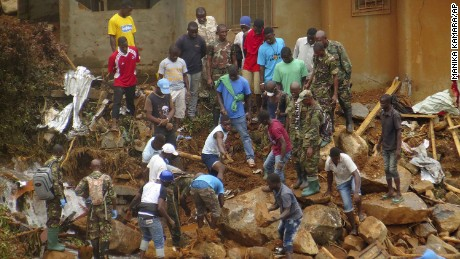 "Volunteers search for bodies from the scene of heavy flooding and mudslides in Regent, just outside of Sierra Leone's capital Freetown. Tuesday, Aug. 15 , 2017. Survivors of deadly mudslides in Sierra Leone's capital are vividly describing the disaster as President Ernest Bai Koroma says the nation is in a ""state of grief."" (AP Photo/ Manika Kamara)"