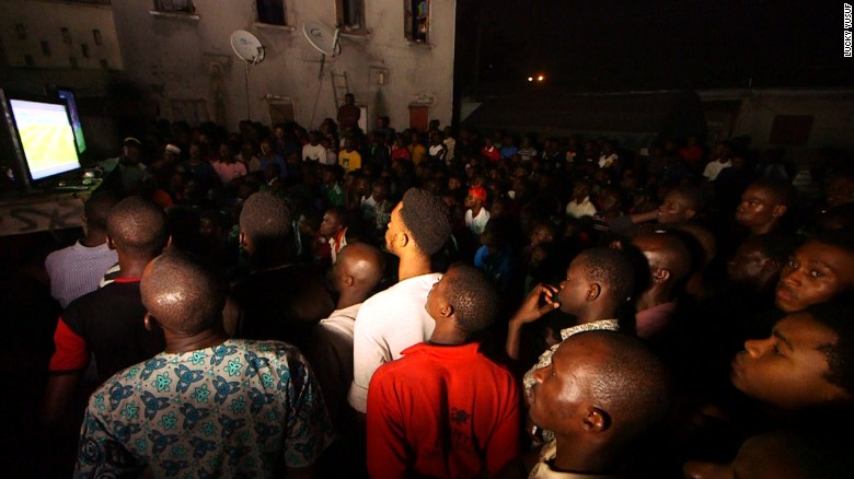 Football fans in Lagos watching a Premier League match