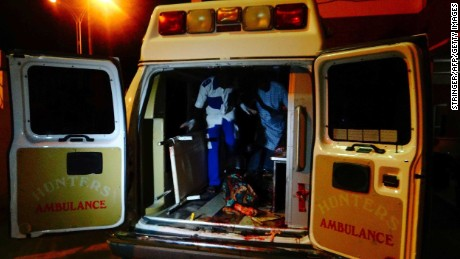An injured victim of a female suicide bomber arrives in an ambulance for medical attention at a Maiduguri hospital in northeast Nigeria on August 15, 2017. Boko Haram female suicide bomber detonated her explosives killing 28 people and leaving over 80 others injured at a market in the village of Konduga on the outskirts of Maiduguri in northeast Nigeria. / AFP PHOTO / STRINGERSTRINGER/AFP/Getty Images