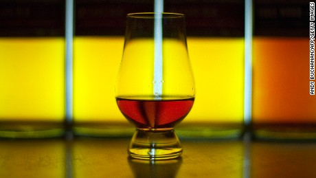 A picture shows a glass of Single Malt whisky produced at the Auchentoshan Distillery, a Single Malt whisky distillery, on the outskirts of Glasgow on December 12, 2016.