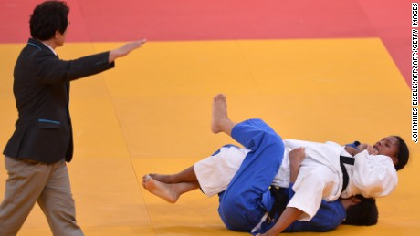 Colombia's Yuri Alvear (white) scores a waza-ari against China's Fei Chen at the London 2012 Olympic Games.