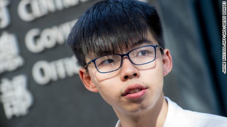 Student protest leader Joshua Wong speaks to the media about his recent arrest and detention ahead of the visit by China's President Xi Jinping, outside Civic Square at the Central Government Offices in Hong Kong on June 30, 2017. Wong was amongst 26 activists arrested the past few days who were released from police custody in the early hours of June 30 after threatening to go to the High Court to petition against their ongoing incarceration. Xi arrived in Hong Kong on June 29 for a three-day visit to mark the 20th anniversary of the territory's handover from British to Chinese rule. / AFP PHOTO / Jayne Russell        (Photo credit should read JAYNE RUSSELL/AFP/Getty Images)