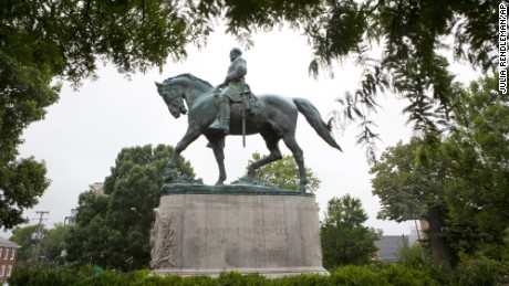 A statue of Confederate general Robert E. Lee sits in Emancipation Park, Tuesday, Aug. 15, 2017, in Charlottesville, Va. The deadly rally by white nationalists in Charlottesville, over the weekend is accelerating the removal of Confederate statues in cities across the nation.  (AP Photo/Julia Rendleman)