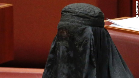 Senator Pauline Hanson wears a burqa in the Senate chamber at Parliament House in Canberra, Australia, Thursday, Aug. 17.
