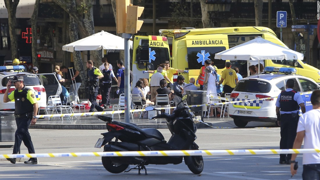 Injured people are treated in Barcelona, Spain, after a van rammed into a crowd of people on Thursday, August 17. Police confirmed that the incident, which occurred near the popular tourist area of Las Ramblas, was a terror attack.