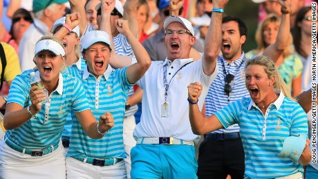 Catriona Matthew (second from left) celebrates Solheim Cup victory in 2013 with her husband and caddy Graeme Matthew.