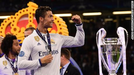 Real Madrid's Portuguese striker Cristiano Ronaldo celebrates next to the trophy after Real Madrid won the UEFA Champions League final football match between Juventus and Real Madrid at The Principality Stadium in Cardiff, south Wales, on June 3, 2017. / AFP PHOTO / JAVIER SORIANO        (Photo credit should read JAVIER SORIANO/AFP/Getty Images)