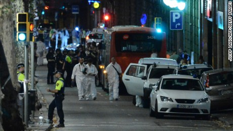 "Forensic policemen arrive in the cordoned off area after a van ploughed into the crowd, killing 13 persons and injuring over 80 on the Rambla in Barcelona on August 17, 2017. A driver deliberately rammed a van into a crowd on Barcelona's most popular street on August 17, 2017 killing at least 13 people before fleeing to a nearby bar, police said.  Officers in Spain's second-largest city said the ramming on Las Ramblas was a ""terrorist attack"". / AFP PHOTO / Josep LAGO        (Photo credit should read JOSEP LAGO/AFP/Getty Images)"