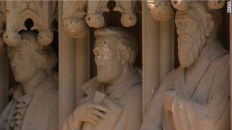 Statue of General Robert E. Lee (center) on the portal of Duke University's chapel was defaced.
