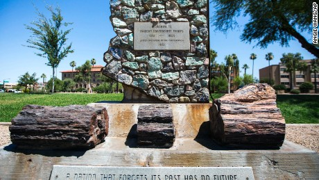 FILE - This June 5, 2017 file photo shows a monument to Arizona Confederate soldiers, presented by the United Daughters of the Confederacy in 1961, amid other memorials at Wesley Bonin Memorial Plaza on the grounds of the Capitol complex in Phoenix. The memorial has been cleaned after it was defaced with paint a second time this week amid controversy over Confederate statutes and other honors. The state Department of Public Safety says troopers on Thursday, Aug. 17, 2017 confirmed that the Confederate Troops Memorial at Wesley Bolin Memorial Plaza had been painted. The DPS says a suspect described as a white man in his 40s was last seen riding a bicycle nearby. (AP Photo/Angie Wang, File)