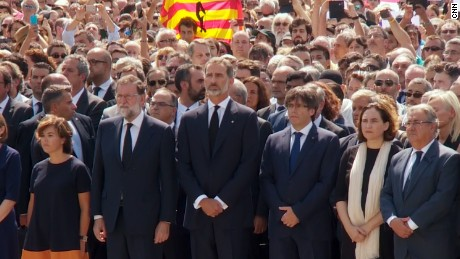 King Felipe VI of Spain leads a moment of silence  in Plaça de Catalunya on Friday.