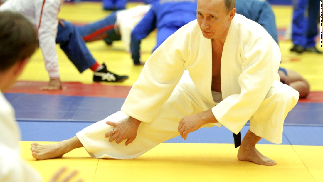 Russian President Vladimir Putin is a judo master, denoted by wearing a black belt.