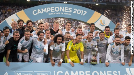 MADRID, SPAIN - AUGUST 16: Sergio Ramos of Real Madrid CF celebrates with teammates with the Supercopa de Espana trophy after beating FC Barcelona 2-0 (3-1) on aggregate in the Supercopa de Espana Final 2nd Leg match between Real Madrid and FC Barcelona at Estadio Santiago Bernabeu on August 16, 2017 in Madrid, Spain. (Photo by Denis Doyle/Getty Images)
