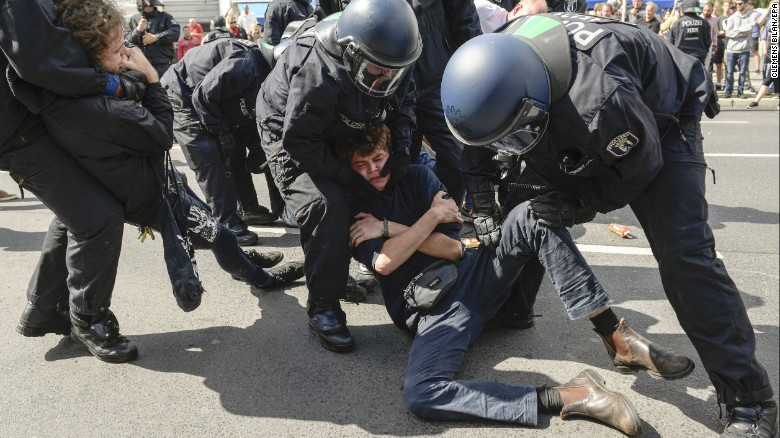 Police detain a counterprotester Saturday during the right-wing march in Berlin.