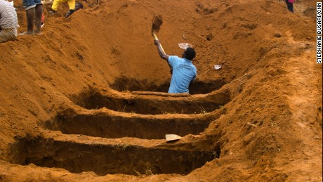 A volunteer digs a grave at the Waterloo Cemetery in Freetown, Sierra Leone on August 17th.