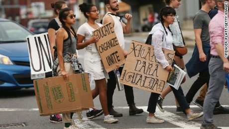 Protesters prepare to march in Boston against a planned 'Free Speech Rally' just one week after the violent 'Unite the Right' rally in Virginia left one woman dead and dozens more injured on August 19, 2017 in Boston, Massachusetts. Although the rally organizers stress that they are not associated with any alt-right or white supremacist groups, the city of Boston and Police Commissioner William Evans are preparing for possible confrontations at the afternoon rally.