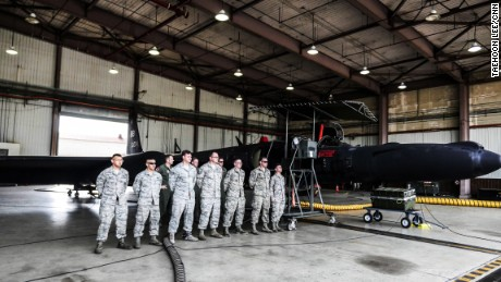 US Air Force crew stand in front of a U-2 spy plane at Osan Air Base, South Korea.
