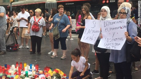 Muslim women denounce terrorism at a memorial Saturday on Las Ramblas in Barcelona.