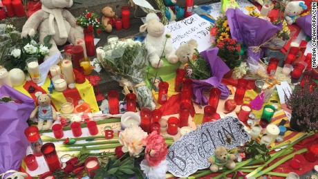 Candles, flowers, toys and messages of solidarity are left at a makeshift memorial on Las Ramblas.
