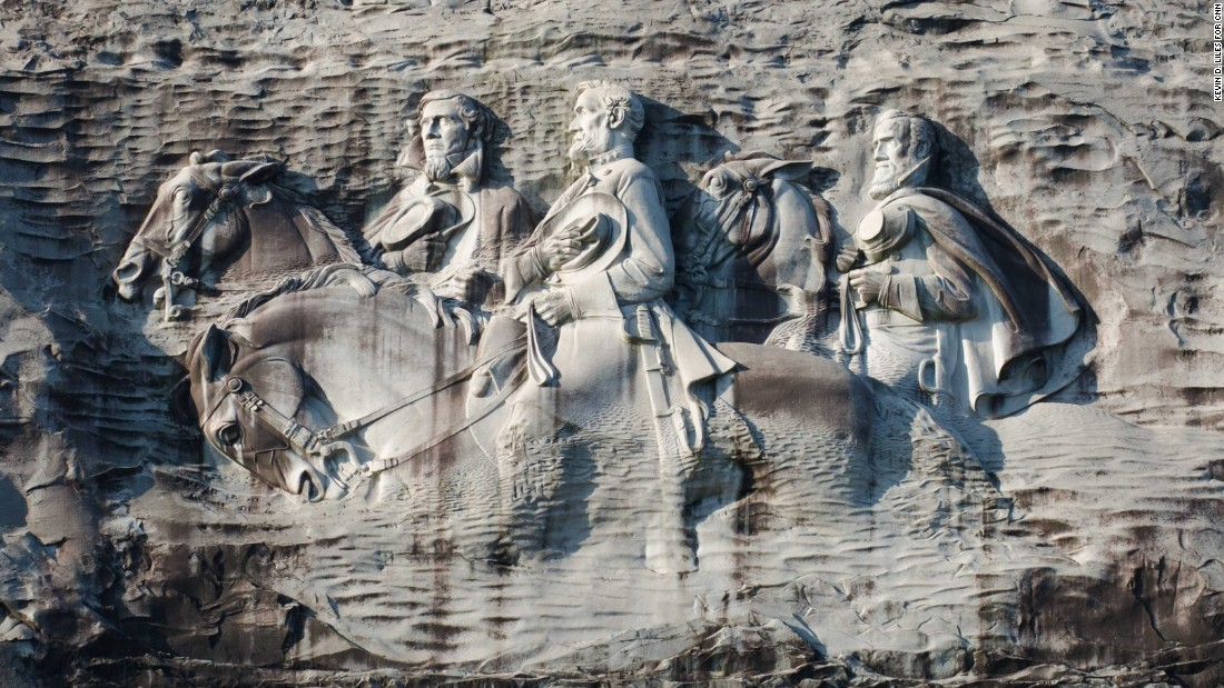 At stone mountain hikers try to rise above its racial