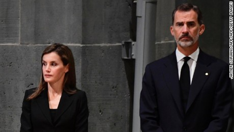 "Spain's King Felipe VI (R) and Spain's Queen Letizia (C) and Portugal's President Marcelo Rebelo de Sousa attend a mass to commemorate victims of two devastating terror attacks in Barcelona and Cambrils, at the Sagrada Familia church in Barcelona on August 20, 2017. A grief-stricken Barcelona prepared today to commemorate victims of two devastating terror attacks at a mass in the city's Sagrada Familia church. As investigators scrambled to piece together the attacks which killed 14 people in all, Interior Minister Juan Ignacio Zoido said on August 19 the cell behind the carnage that also injured 120 and plunged the country into shock had been ""dismantled,"" though local authorities took a more cautious tone.   / AFP PHOTO / JAVIER SORIANO        (Photo credit should read JAVIER SORIANO/AFP/Getty Images)"