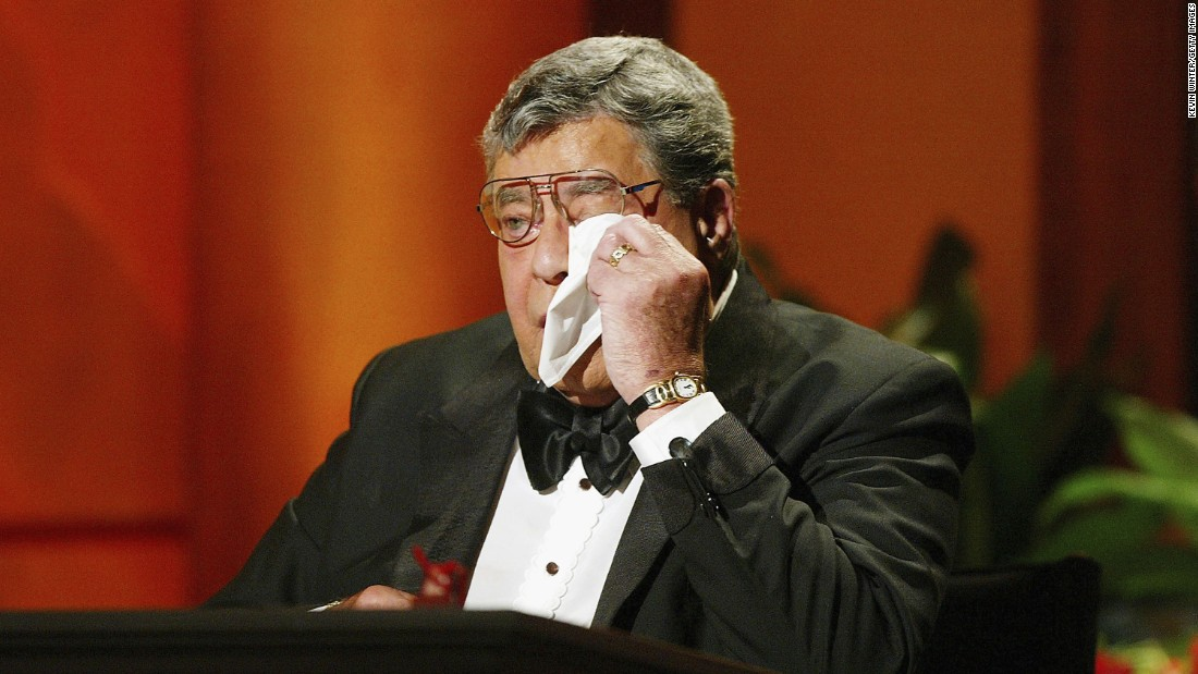 Lewis wipes away tears at the 39th Annual Jerry Lewis MDA Labor Day Telethon in 2004. In 2011, Lewis and the Muscular Dystrophy Association announced they were parting ways.