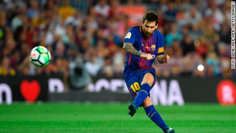Barcelona's Argentinian forward Lionel Messi kicks the ball during the Spanish league footbal match FC Barcelona vs Real Betis at the Camp Nou stadium in Barcelona on August 20, 2017.