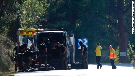 Members of TEDAX-NRBQ (Technician Specialist in Deactivation of Explosive Artifacts) on the site where Moroccan suspect Younes Abouyaaqoub was shot on August 21, 2017 near Sant Sadurni d'Anoia, south of Barcelona, four days after the Barcelona and Cambrils attacks that killed 15 people. Spanish police said on August 21, 2017 that they have identified the driver of the van that mowed down pedestrians on the busy Las Ramblas boulevard in Barcelona, killing 13. The 22-year-old Moroccan Younes Abouyaaqoub is believed to be the last remaining member of a 12-man cell still at large in Spain or abroad, with the others killed by police or detained over last week's twin attacks in Barcelona and the seaside resort of Cambrils that claimed 14 lives, including a seven-year-old boy. / AFP PHOTO / LLUIS GENE        (Photo credit should read LLUIS GENE/AFP/Getty Images)