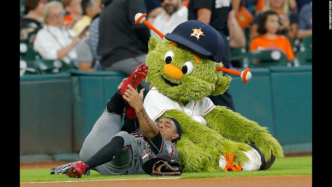 Ketel Marte stretches with the Houston Astros' mascot, Orbit, before a game on Thursday, August 17.