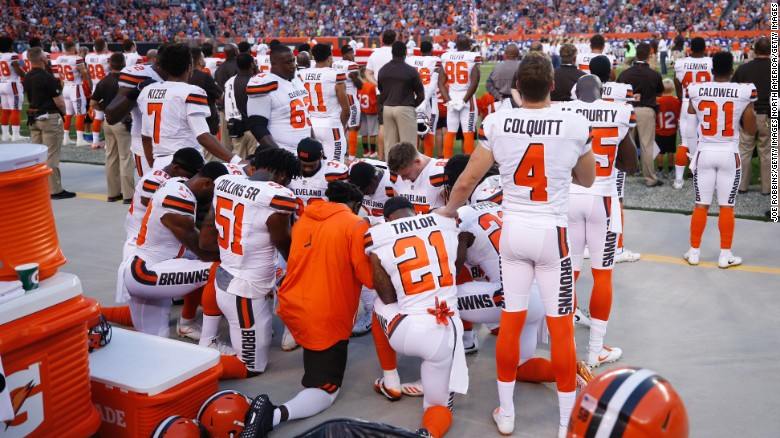 A group of Cleveland Browns players kneel in a circle in protest during the national anthem prior to a preseason game against the New York Giants at FirstEnergy Stadium on August 21, 2017 in Cleveland, Ohio.
