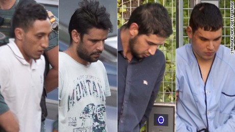 Left to right: Driss Oukabir, Mohamed Aallaa, Salah El Karib, Mohamed Houli Chemlal, suspected of involvement in the terror cell that carried out twin attacks in Spain, is escorded by Spanish Civil Guards from a detention center in Tres Cantos, near Madrid, on August 22, 2017 before being tranferred to the National Court. Under heavy security, police vans entered the National Court, which deals with terrorism cases, where a judge will question them and decide what -- if any -- charges to press against them over the vehicle attacks that left 15 dead and 120 injured.