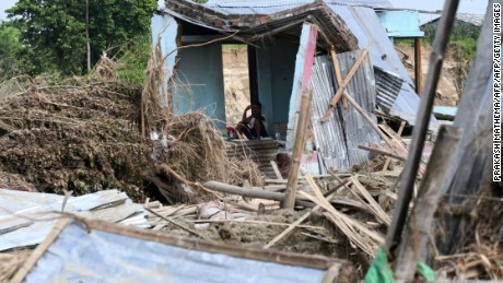 A man rests in his house damaged by flood in Itahari, Sunsari district, some 250 kms from Nepal's capital Kathmandu, on August 16, 2017.