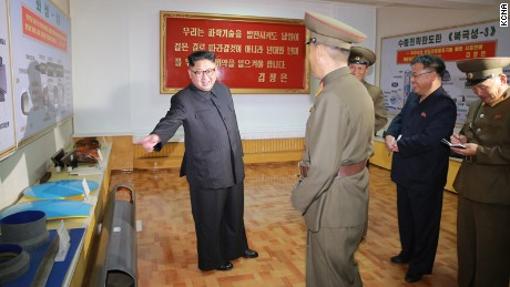 "Undated images released by North Korea state media KCNA purport to show leader Kim Jong Un conducting  ""field guidance"" at the Chemical Material Institute of the Academy of Defense Science. According to KCNA: ""After looking round the newly-built room for the education in the revolutionary history and exhibition hall of scientific and technological achievements, he learned about the processes for manufacturing ICBM warhead tip and solid-fuel rocket engine."" The KCNA report added that Kim was accompanied on the tour by Jo Yong Won and Kim Jong Sik, vice department directors of the C.C., the Workers' Party of Korea.""  --- dateline on report says Pyongyang"